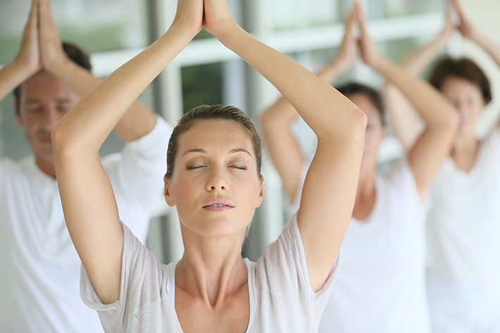 group-doing-yoga-relax-meditation