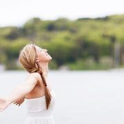 woman extending her arms happily