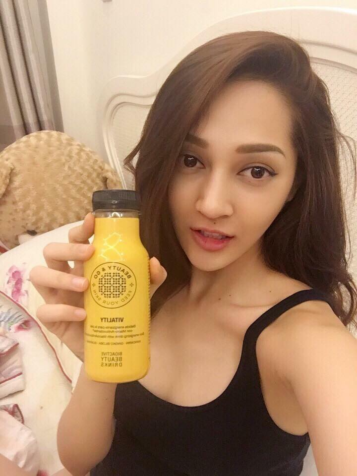 woman holding beauty and go drink