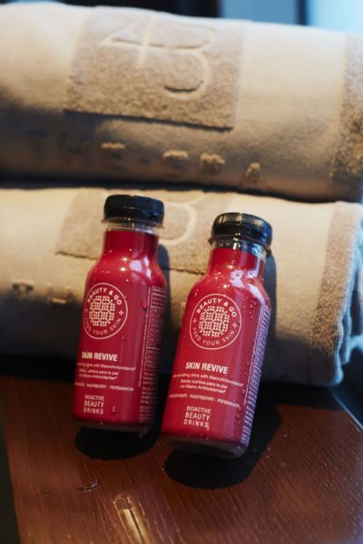 spa towels with red bottles