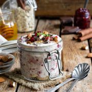 overnight oatmeal in a jar with cherry jam and chocolate