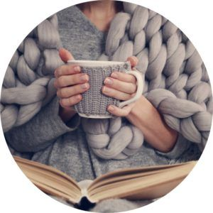 girl reading book with a hot tea