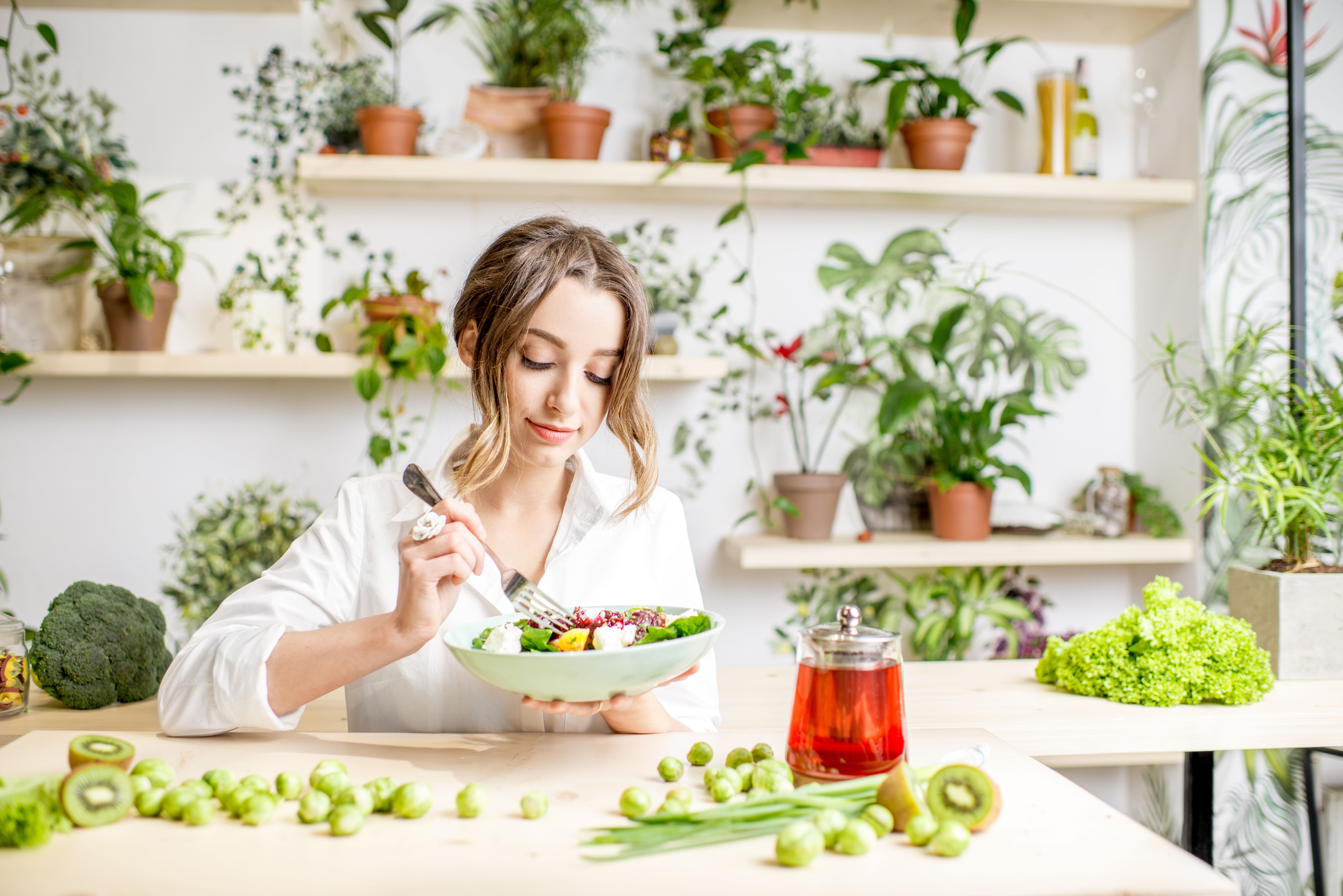 Woman with healthy spring vegetables