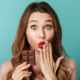 surprised woman eating chocolate