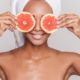woman-holding-orange-slice-with-towel
